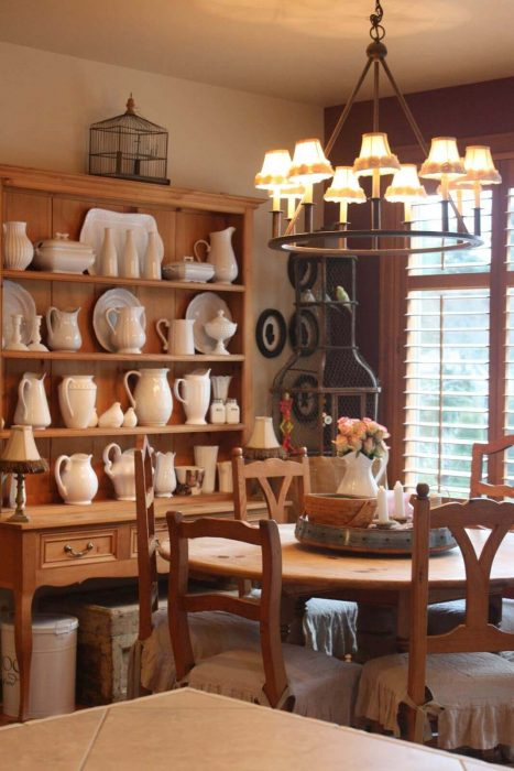 French Country Decor Ideas - Warm Wood Dining Room with Stoneware Display - Cabritonyc.com