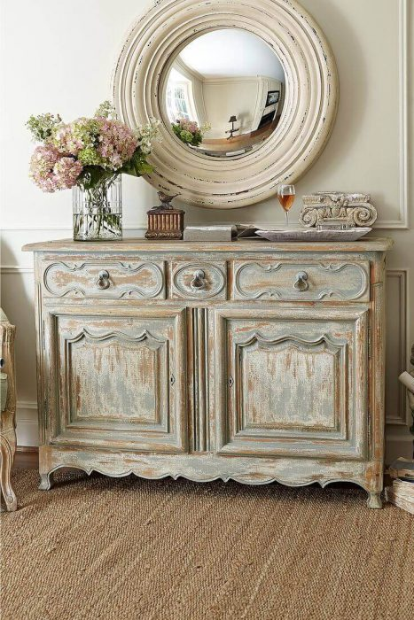 French Country Decor Ideas - Antiqued Credenza and Rustic Round Mirror - Cabritonyc.com