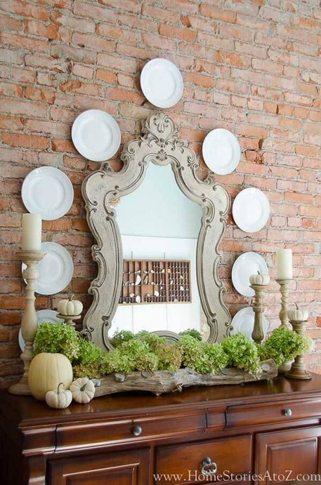 French Country Decor Ideas - Elegant Buffet Against Contrasting Exposed Brick Wall - Cabritonyc.com