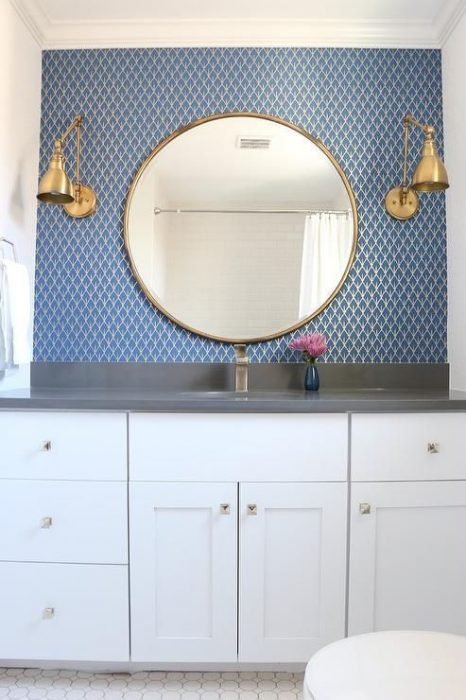 Bathroom Mirror Ideas With Brass-Framed Round Mirror and Blue Wallpaper