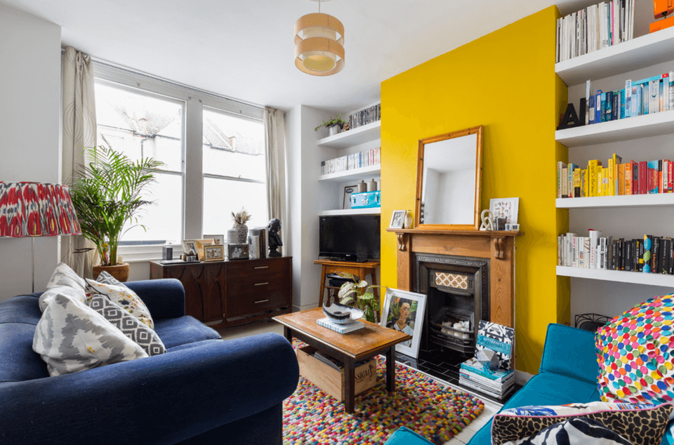 Accent Wall Ideas - Bright Yellow Living Room - Cabritonyc.com