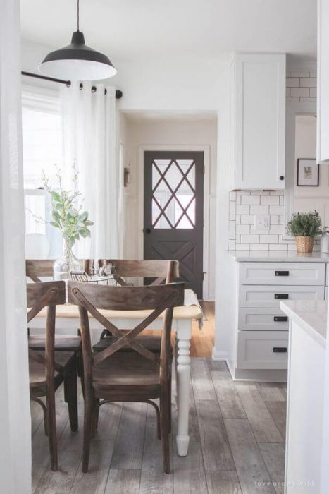 Farmhouse Kitchen Decor Design Ideas - Eat-In Kitchen Dinette with Distressed X-Back Chairs - Cabritonyc.com