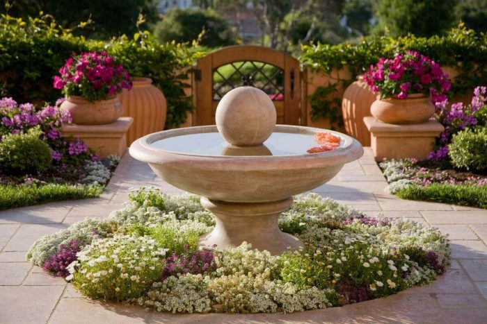 Front Yard Landscaping Ideas - Elegant Mediterranian Inspired Fountain Bed - Cabritonyc.com